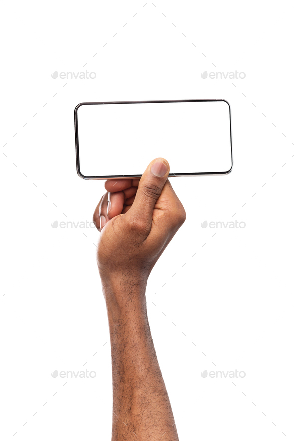 Smartphone with blank screen in horizontal orientation in man's hands - Stock Photo - Images