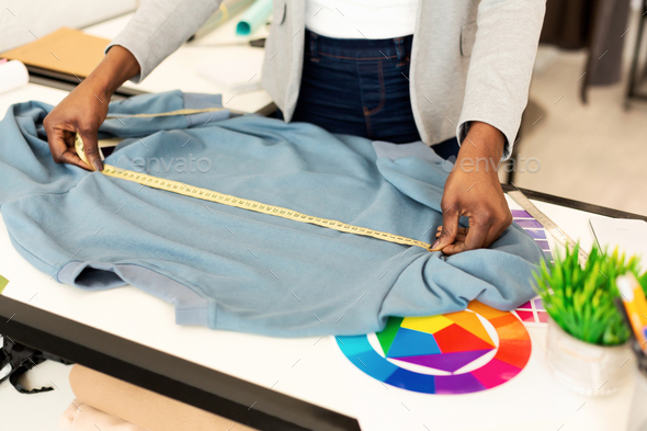 Unrecognizable Clothing Designer Working On A Garment In Atelier, Cropped - Stock Photo - Images