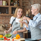 Young woman helping her old mother with dinner - PhotoDune Item for Sale