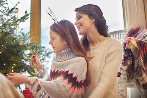 Girl helping mummy with decorating - Stock Photo - Images