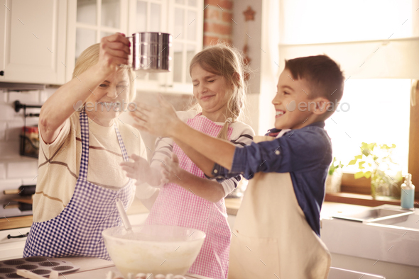 Playful kids having fun with the flour - Stock Photo - Images