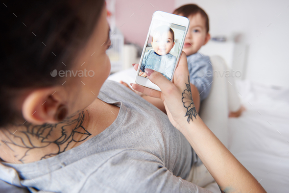 Mummy taking selfie of little son - Stock Photo - Images