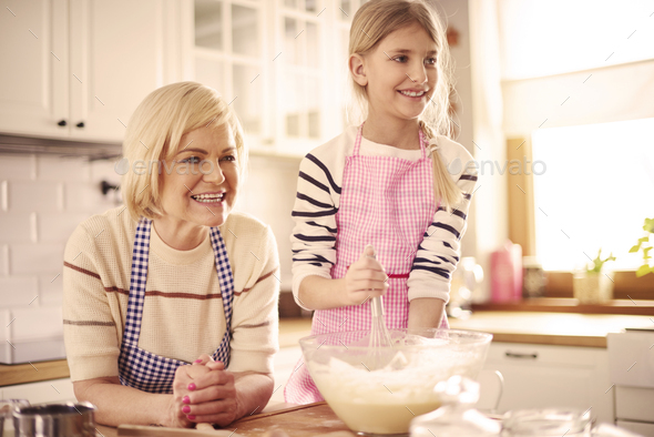 Elementary age kid making the pastry - Stock Photo - Images
