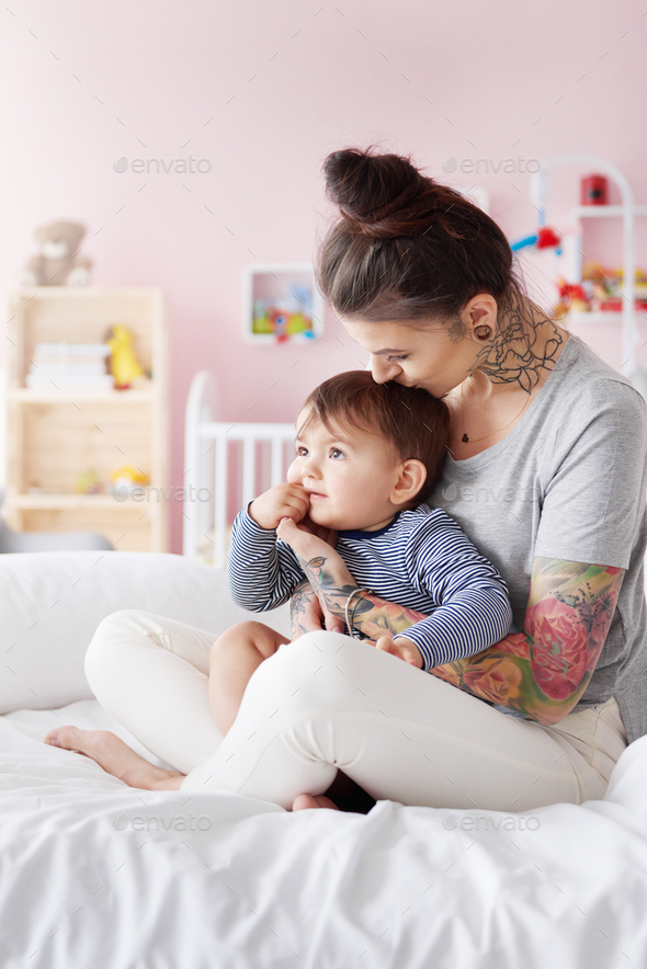 Stylish mother with her little baby - Stock Photo - Images