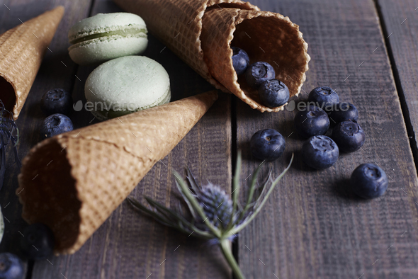 Biscuits and fruits on the wooden table - Stock Photo - Images