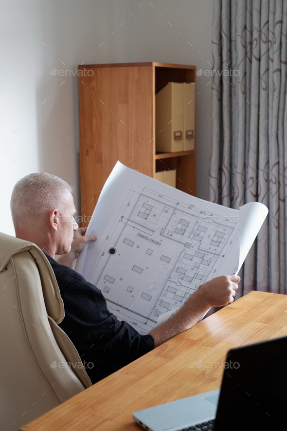 Man Checking Construction Plan - Stock Photo - Images