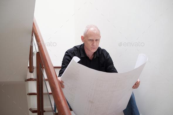 Architect Examining Draft - Stock Photo - Images