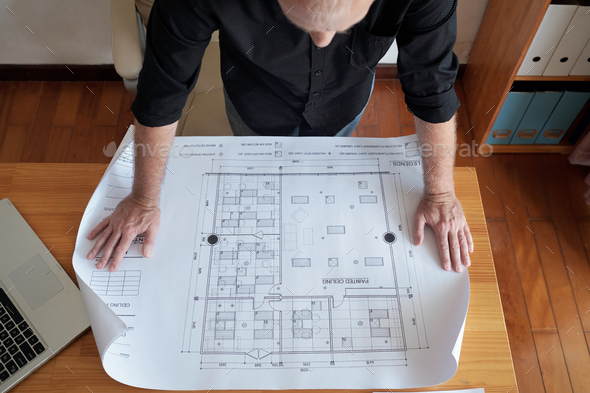 Engineer Examining Construction Plan - Stock Photo - Images