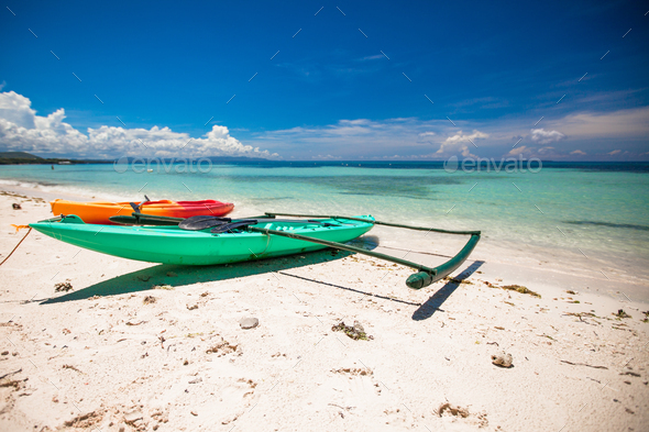 Small boat on the white sandy tropical beach - Stock Photo - Images