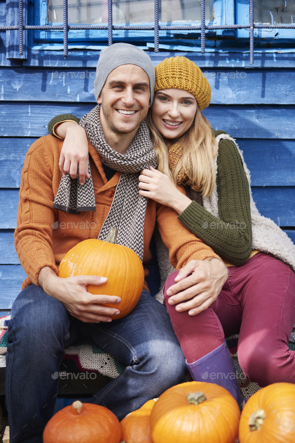 Loving couple resting after the picking pumpkins - Stock Photo - Images