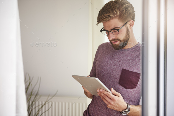 Stylish man using digital tablet - Stock Photo - Images