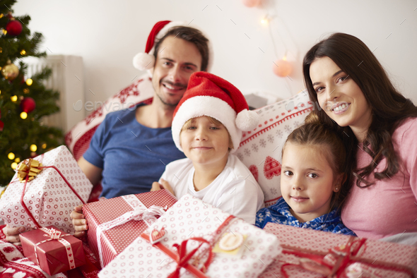 Family spending Christmas morning in bed - Stock Photo - Images