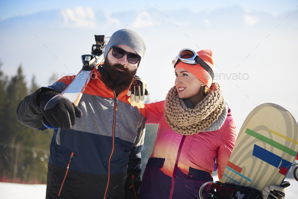 Young couple on the ski trip - Stock Photo - Images