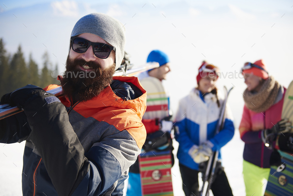 Bearded man with ski equipment - Stock Photo - Images