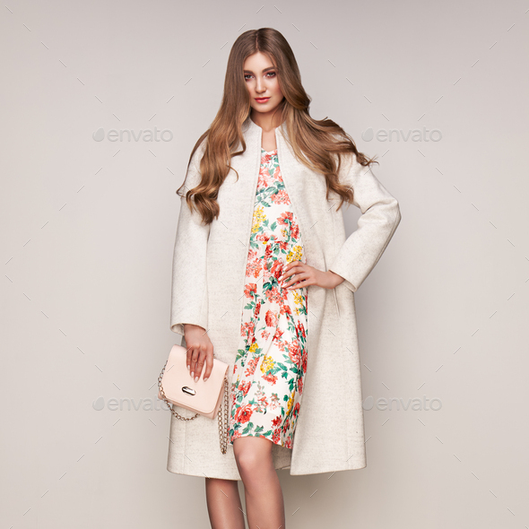 Young woman in white autumn coat - Stock Photo - Images