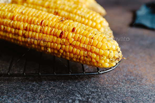 Roasted or grill corn cob with olive oil and salt on a rack - Stock Photo - Images