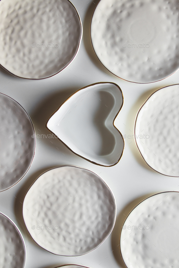 Beautiful plates on a white background with cotton. Beautiful layout - Stock Photo - Images