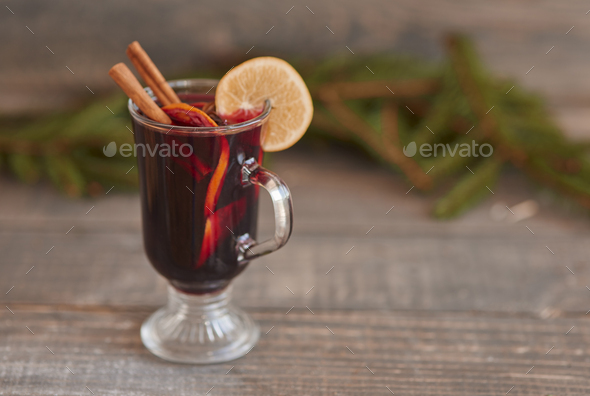 Mulled wine with cinnamon stick and lemon - Stock Photo - Images