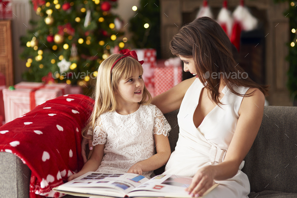 One of parent reading to daughter - Stock Photo - Images