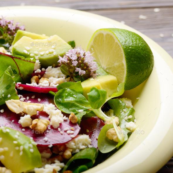 Mediterranean roasted beet salad with avocado walnuts feta chees - Stock Photo - Images