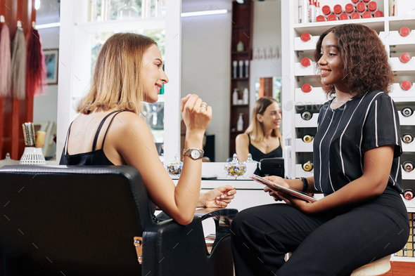 Hair colorist talking to client - Stock Photo - Images