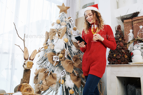 Lovely woman sending text messages - Stock Photo - Images