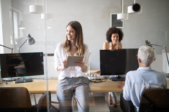 Programmer working in a software developing company office - Stock Photo - Images