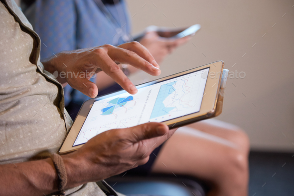 Analyzing financial report - Stock Photo - Images