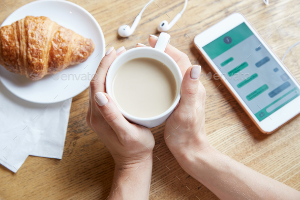 Woman enjoying warm coffee - Stock Photo - Images