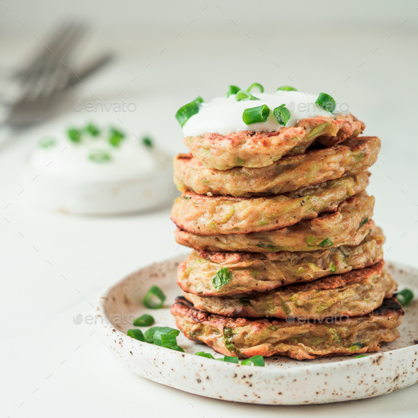 Traditional zucchini fritters, served sour cream - Stock Photo - Images