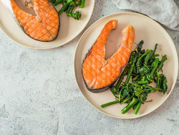 Ready-to-eat grilled salmon steak and greens - Stock Photo - Images