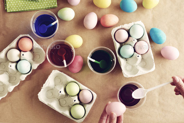 Dyeing eggs is one of the Easter traditions - Stock Photo - Images