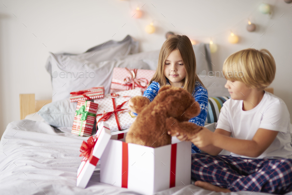 Morning open Christmas presents in the bed - Stock Photo - Images