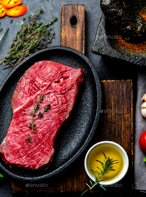 Fresh raw meat beef steak. Beef tenderloin, spices, herbs - Stock Photo - Images