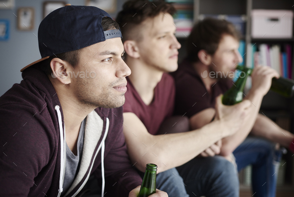 Side view of three confident fans - Stock Photo - Images