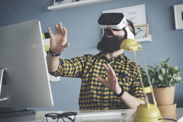 Close up of man wearing virtual reality headset - Stock Photo - Images