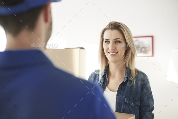 Expressing delight at receiving her express delivery - Stock Photo - Images