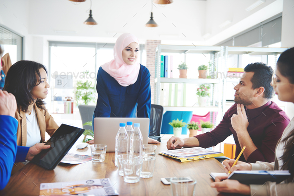 Business people exchanging their ideas - Stock Photo - Images