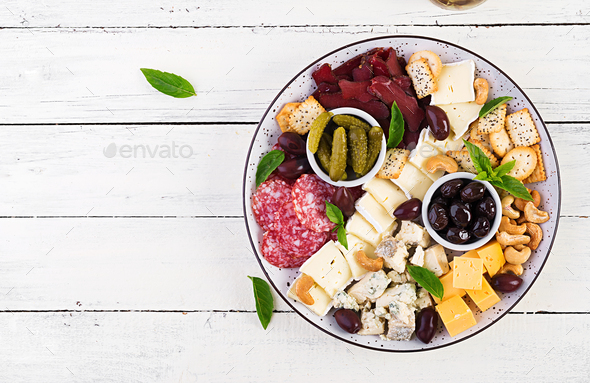 Antipasto platter with basturma, salami, blue cheese, nuts, pickles and olives - Stock Photo - Images