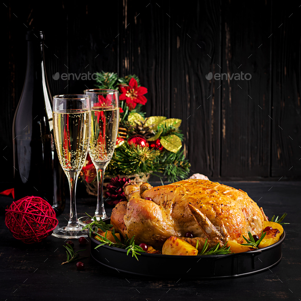 Baked turkey or chicken. The Christmas table is served with a tu - Stock Photo - Images