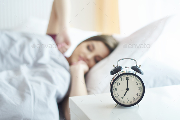 Seven oclock so time to get up - Stock Photo - Images