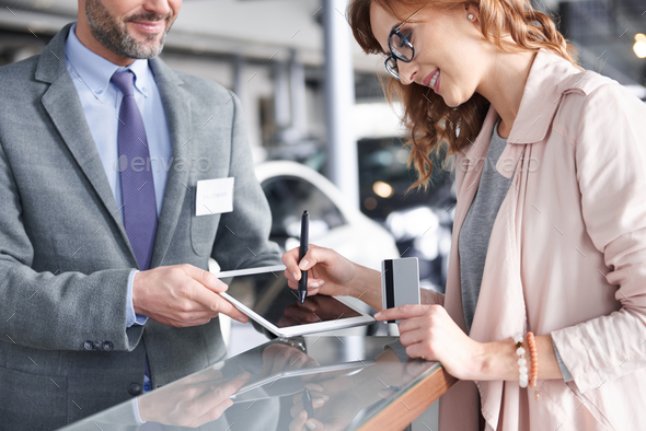 Salesman using digital tablet to sign in - Stock Photo - Images