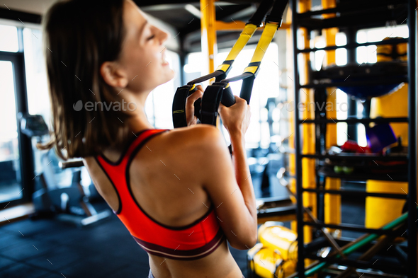 Beautiful fit young woman training in gym - Stock Photo - Images