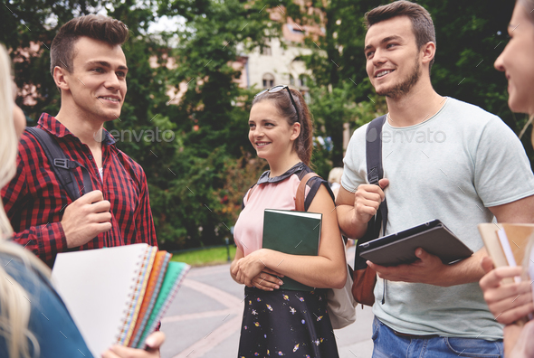 Group of students meeting outdoors - Stock Photo - Images