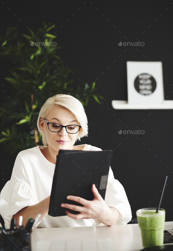 Woman surfing the net on digital tablet - Stock Photo - Images