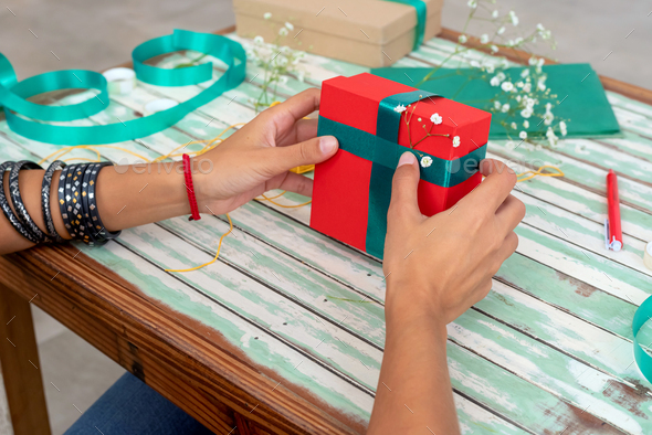 Detail of female hands wrapping gifts - Stock Photo - Images