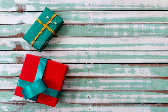 Gifts on a rustic table with an empty copyspace - Stock Photo - Images