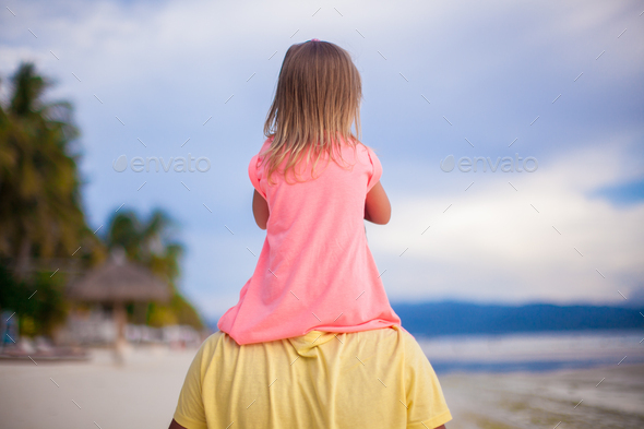 Little girl have fun with her dad at tropical beach - Stock Photo - Images