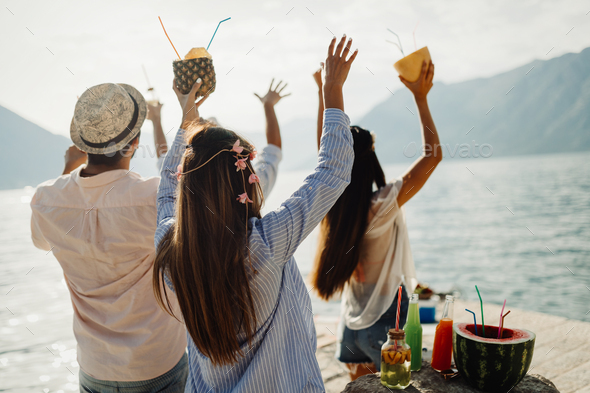 Group of happy friends partying and having fun on summer vacation - Stock Photo - Images