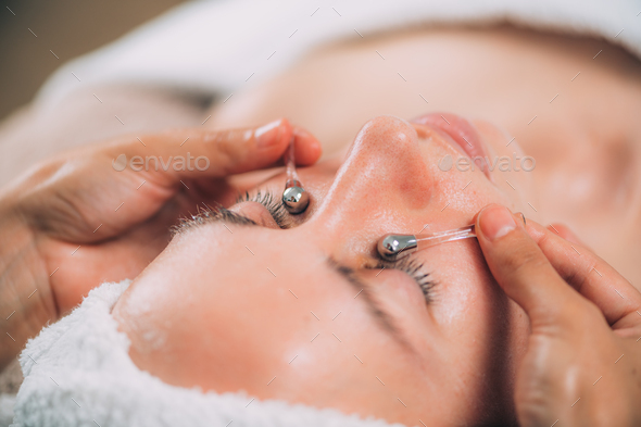 Face Massage with Lymphatic Drainage Sticks for Dark Circles Under the Eyes - Stock Photo - Images